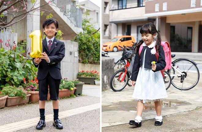 1の文字を持つ男の子と歩く女の子